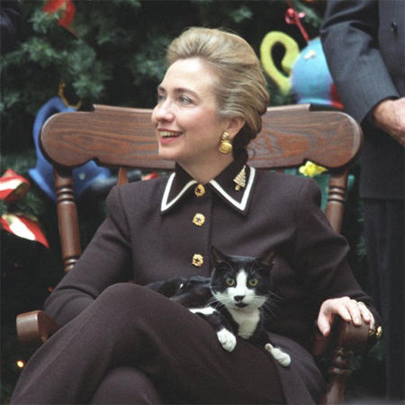 image of Hillary Clinton while First Lady, sitting with Socks the Black and White Cat in her lap