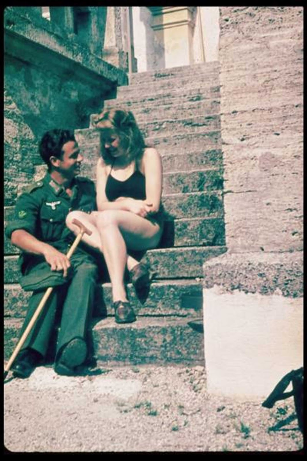 Rare color selfie of a Wehrmacht soldier and his girl. His cane suggests that he was recuperating from a war wound, rear area hospitals were one of the few times a soldier could relax and have a little fun.