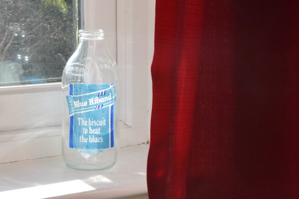 vintage milk bottle windowsill blue riband charity shop