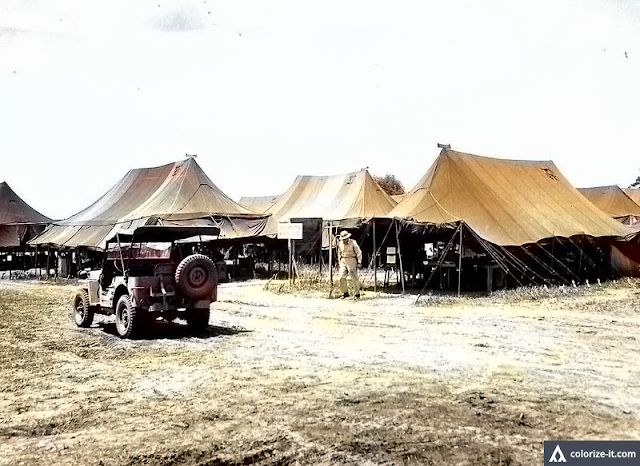 The US Army Signal Corps tent quarters, Base R, Batangas 1945.  Image source:  United States National Archives.  Colorized courtesy of Algorithmia.
