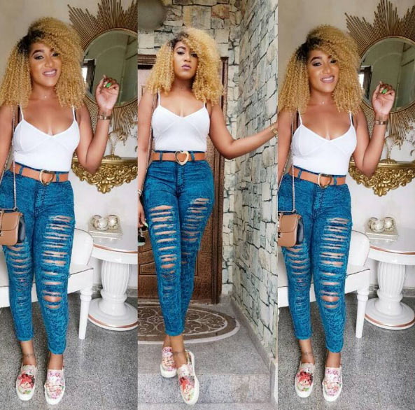Rukky Sanda steps out in ripped jeans + tank top