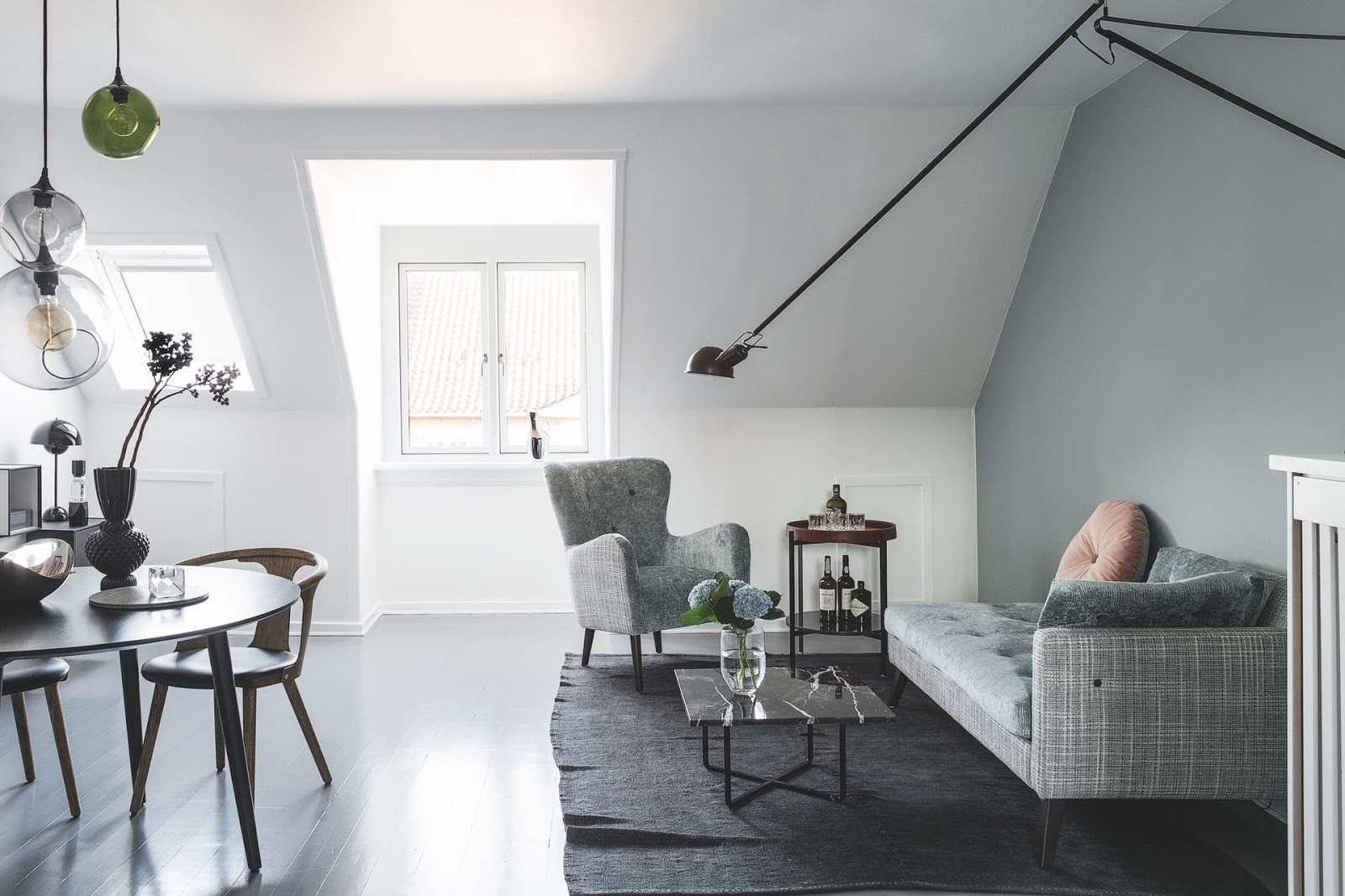Nordic penthouse with muted pastel colors, flos wall lamp and panton lamp