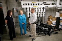 Hillary Rodham Clinton on Monday toured a Des Moines Area Regional Transit Authority station with Elizabeth Presutti, general manager, and Keith Welch, building superintendent. (Credit: Charlie Neibergall/Associated Press) Click to Enlarge.