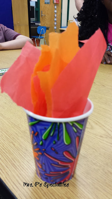 photo of cup with tissue paper in it