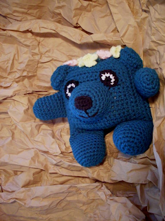 teal crochet flowerumi bear with flowery hairdo