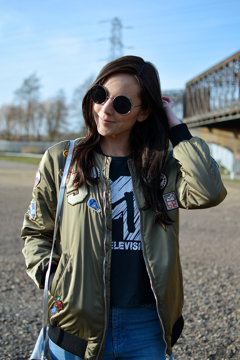 bomber jacket with pins and patches