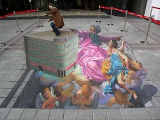 arte anamorfico con pasteles en la calle
