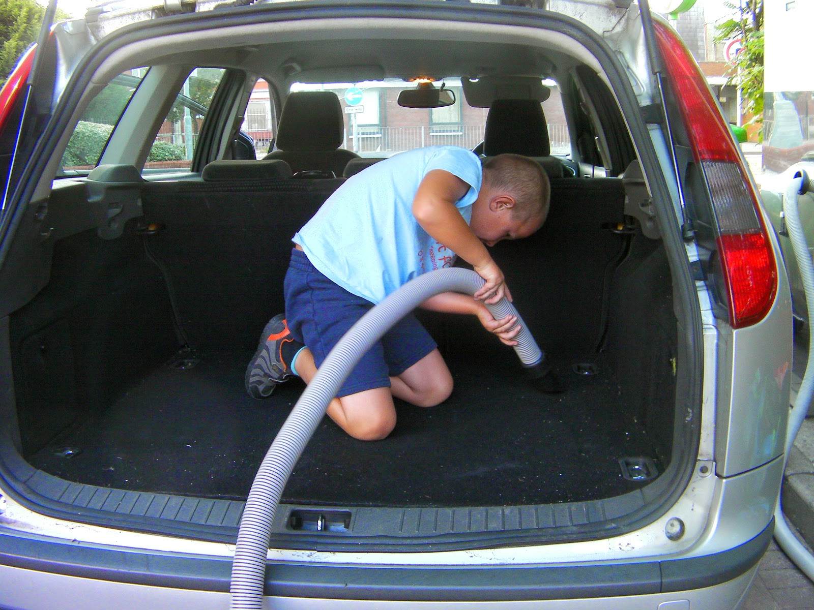 ford focus estate vacuuming the interior at petrol station