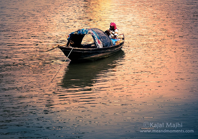 man on boat, boat on river ganga, fishing boat in ganga