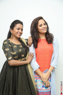 Actress Suma in Black Salwar Suit and Anusuya in orange Dress at winner movie press meet part 1 February 2017 (38).JPG
