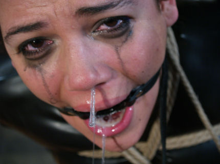 image Ring gagged masked slut in black pvc brutally deepthroated
