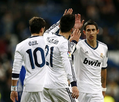 Callejon and Di Maria celebrate their goals against Alcoyano