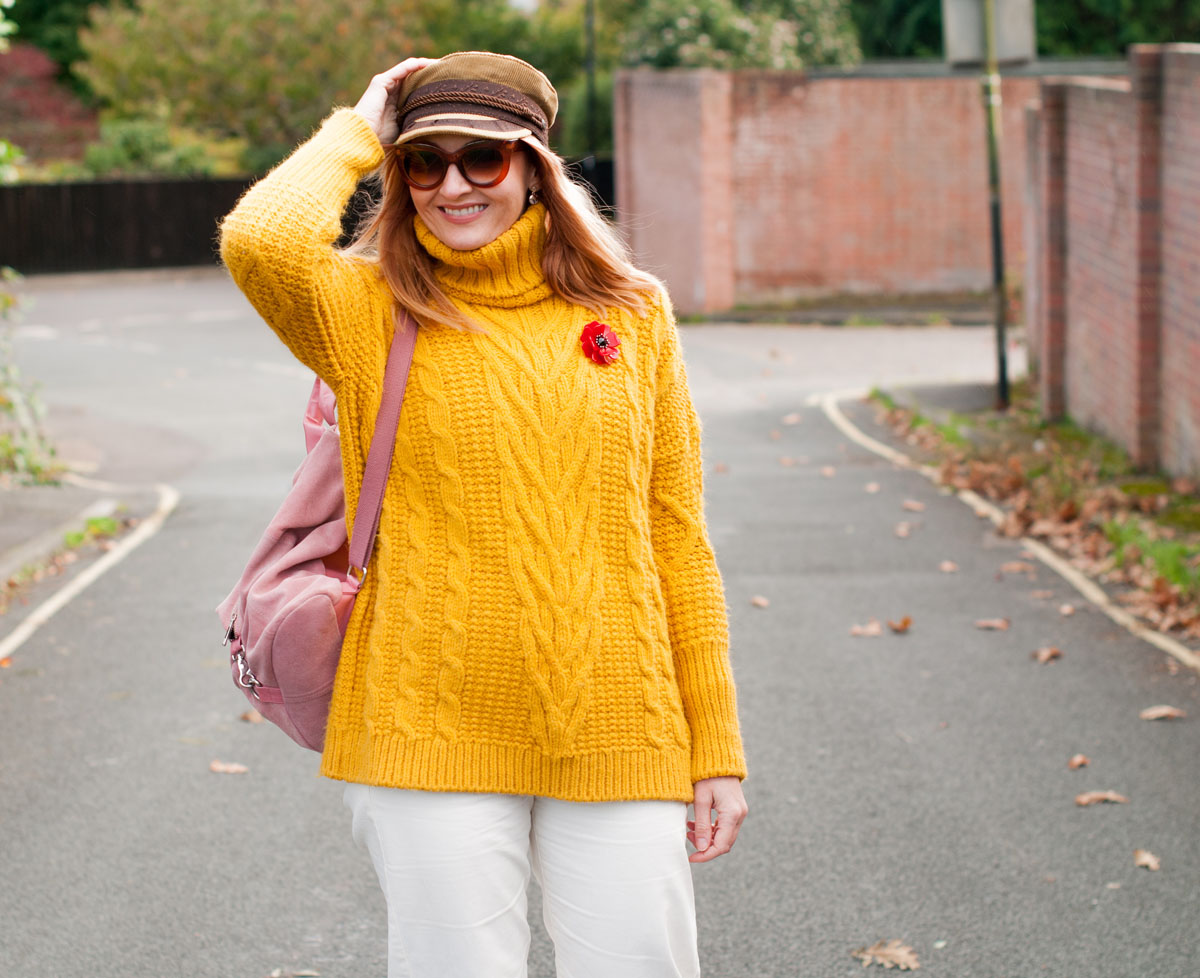 Autumn winter fall style - casual fall dressing - Mustard M&S cable knit oversized roll neck sweater white cropped wide leg jeans tan boots camel baker boy hat pink suede backpack | Not Dressed As Lamb, over 40 style