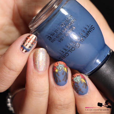 hand painted nail art design of fall leaves and pumpkin over a blue background for Thanksgiving