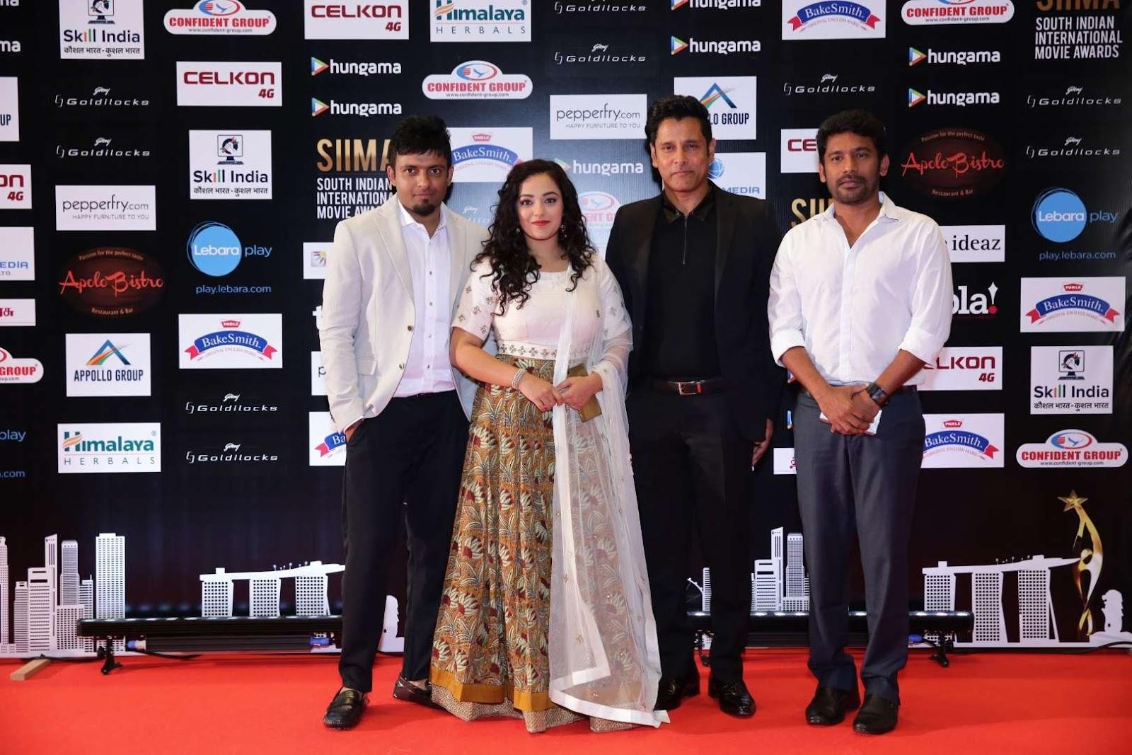 Iru Mugan stars Vikram and Nithya Menon were present at SIIMA