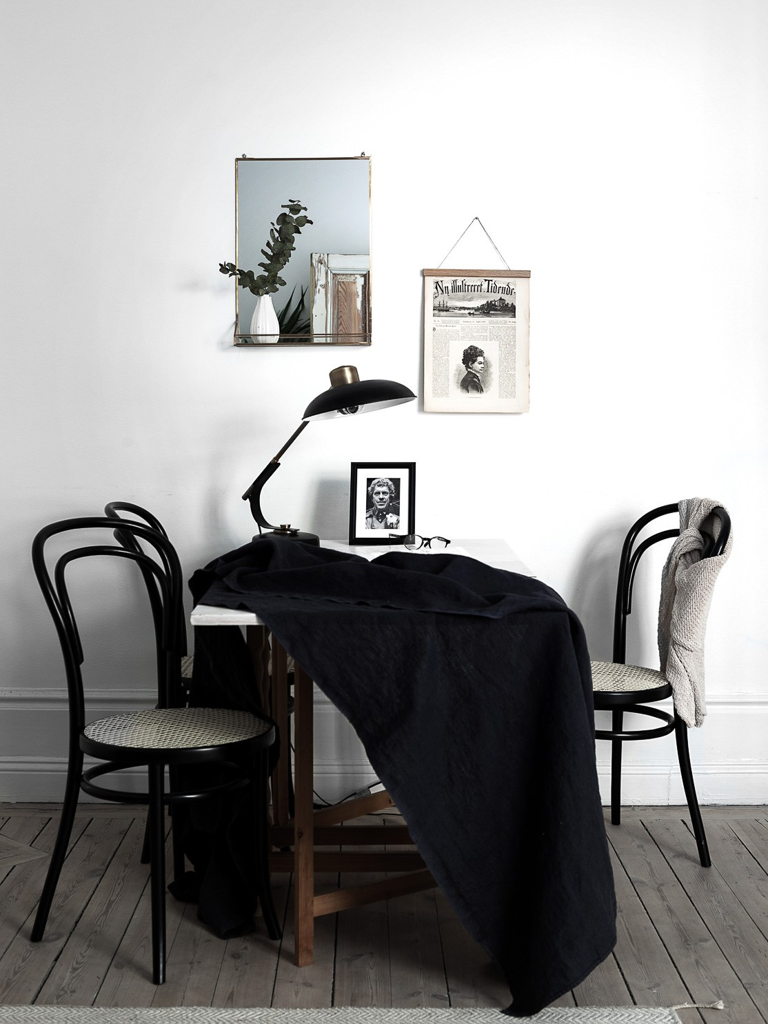 high ceilings apartment with wooden floors, white painted walls, danish design, wriing table