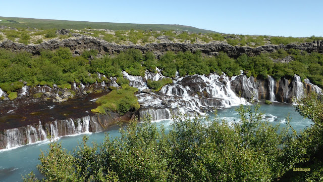 Wallpaper met Hraunfossar watervallen in IJsland