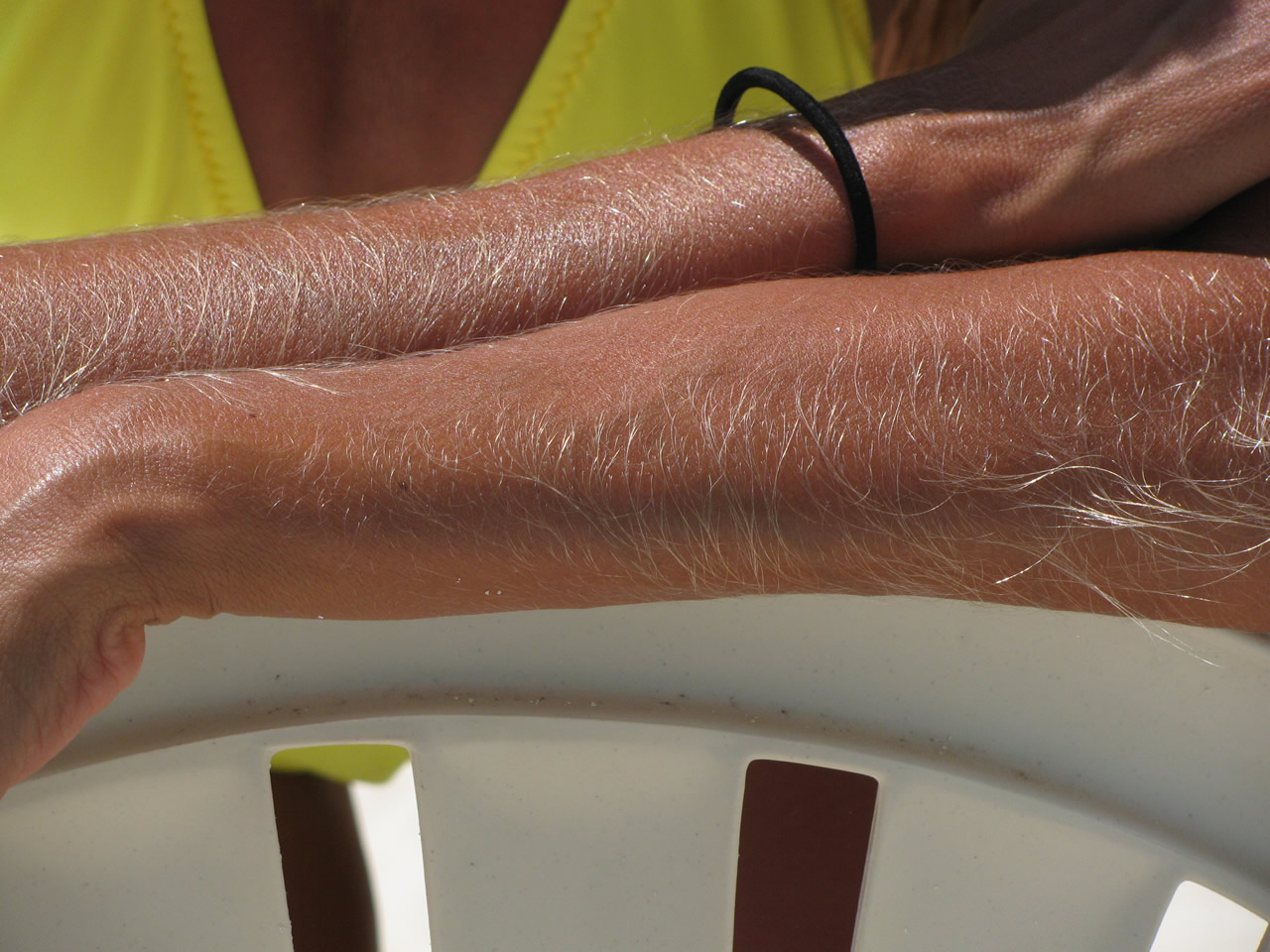 blonde hair on women forearm
