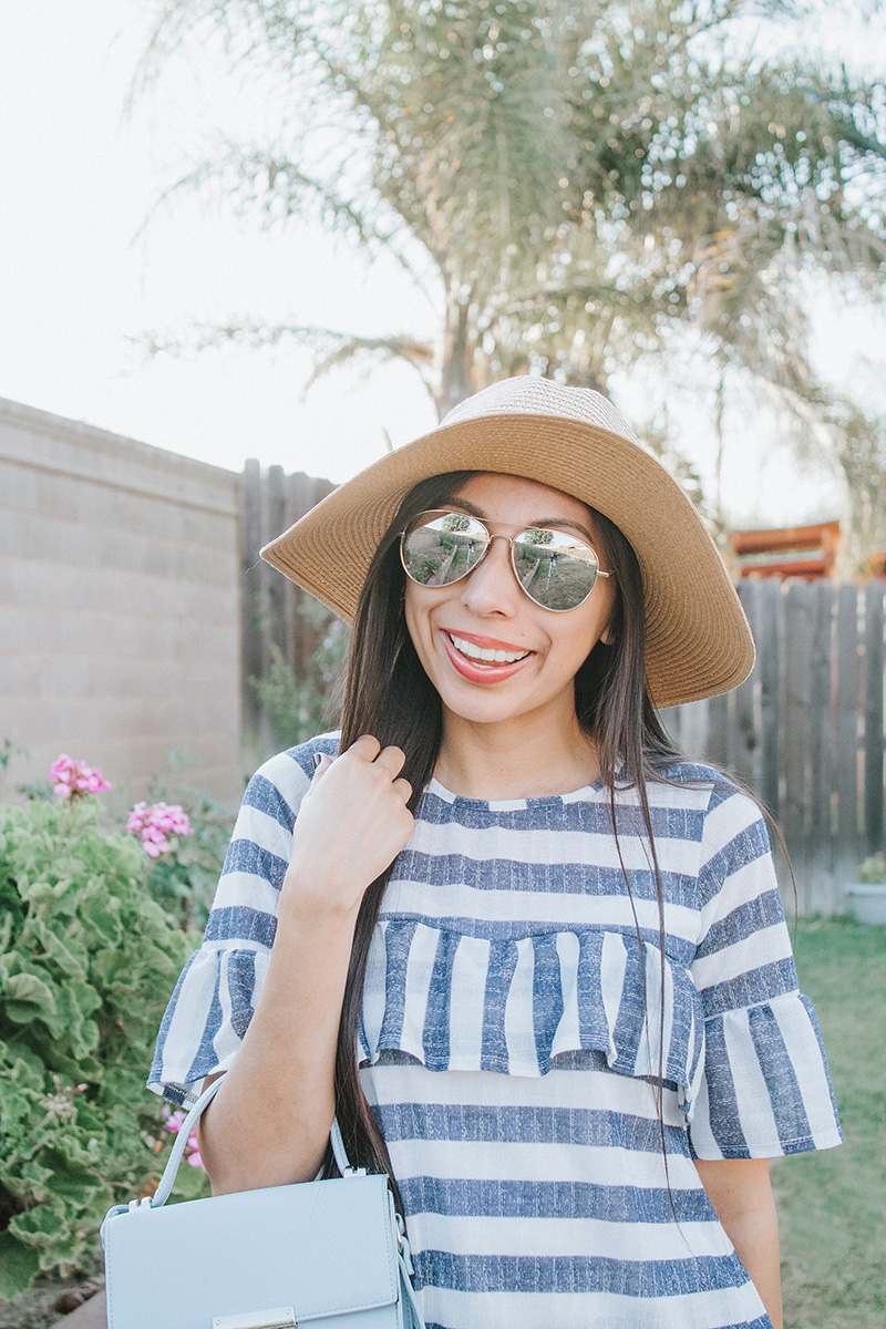 blue striped ruffle blouse with sunglasses and hat
