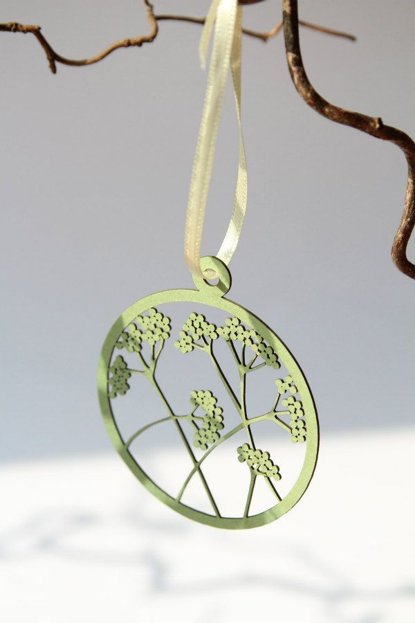 pale green laser cut floral circular paper pendant on ribbon