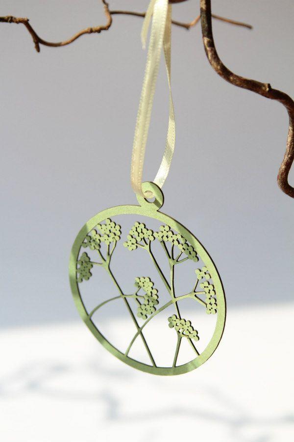 pale green laser cut floral circular paper pendant on ribbon