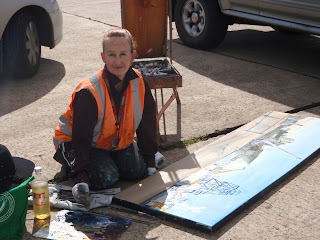 Industrial heritage artist Jane Bennett  painting the ex HMAS Adelaide en plein air on Glebe Island Wharf