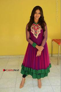 Actress Pooja Jhaveri Latest Stills in Purple Salwar Kameezt at Dwaraka Success Meet  0244.JPG