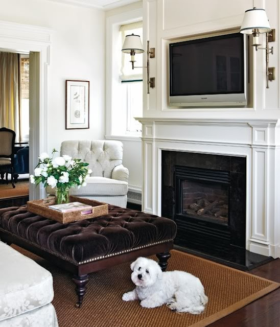 The Tv Is Surrounded With Decorative Molding That Extends From Top Of Mantel All Way Up To Ceiling And