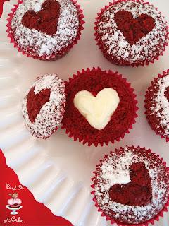 http://birdonacake.blogspot.com/2014/01/hidden-heart-red-velvet-cupcakes.html