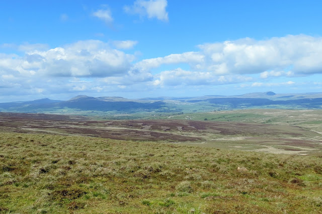 A hazy view across the moors to Whernside, Ingleborough and Pen-y-Ghent on the horizon.