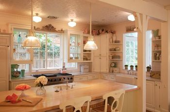 Charming European inspired farmhouse kitchen in beach cottage by Brooke Giannetti