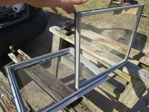taking the two halves of an aluminum trailer window apart