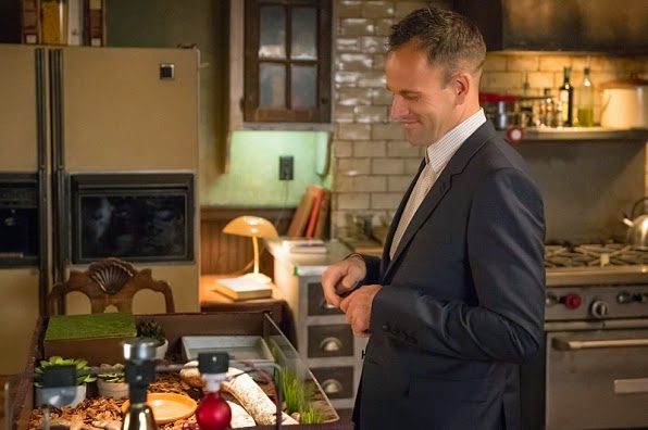 Sherlock Holmes cooking in the kitchen in CBS Elementary Season 3 Episode 5 Rip Off