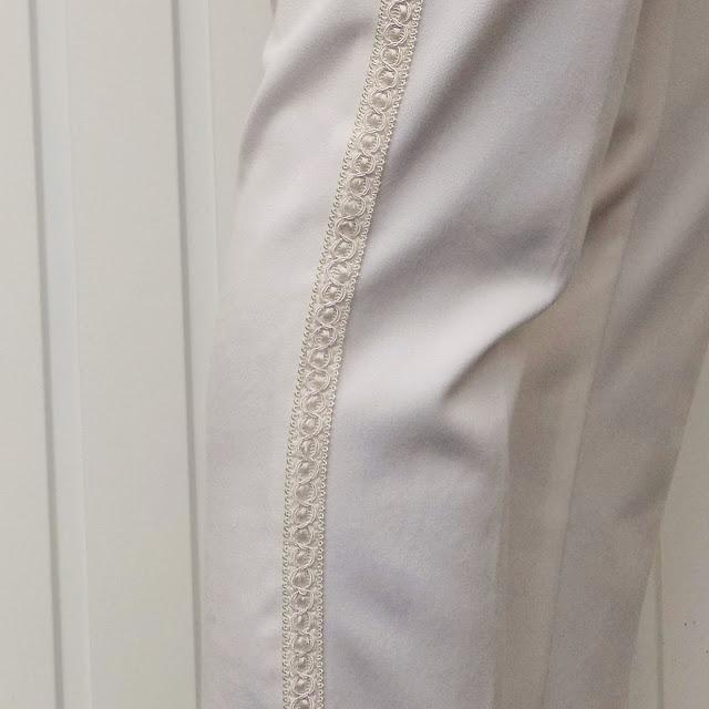 Sequinned tunic, cream trousers, colour block t bar court shoes and leopard print wrap bracelet