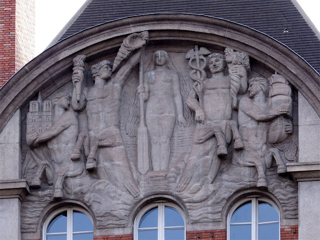 Bas-reliefs on the façade of a building, Quai de Conti, Paris