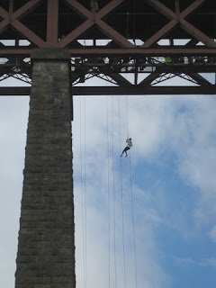 Person abseiling from the Forth Bridge, South Queensferry, Scotland