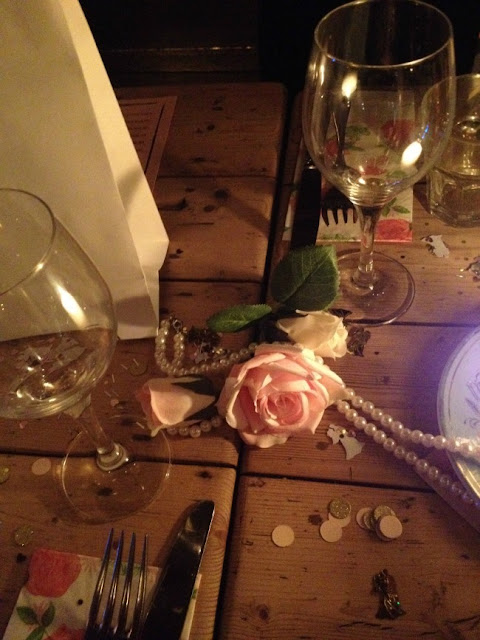 picture of flowers, pearls decorating table at Cosy Club Cardiff