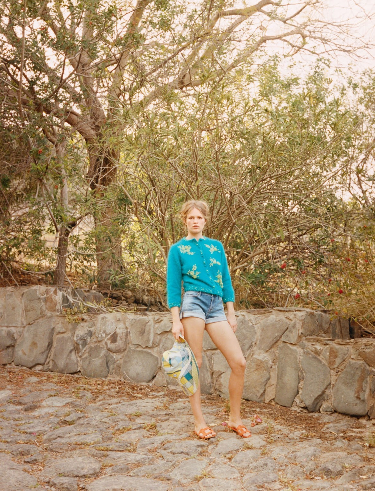 Prada cardigan; Calvin Klein Jeans shorts; Patricia Underwood hat; Manolo Blahnik sandals.