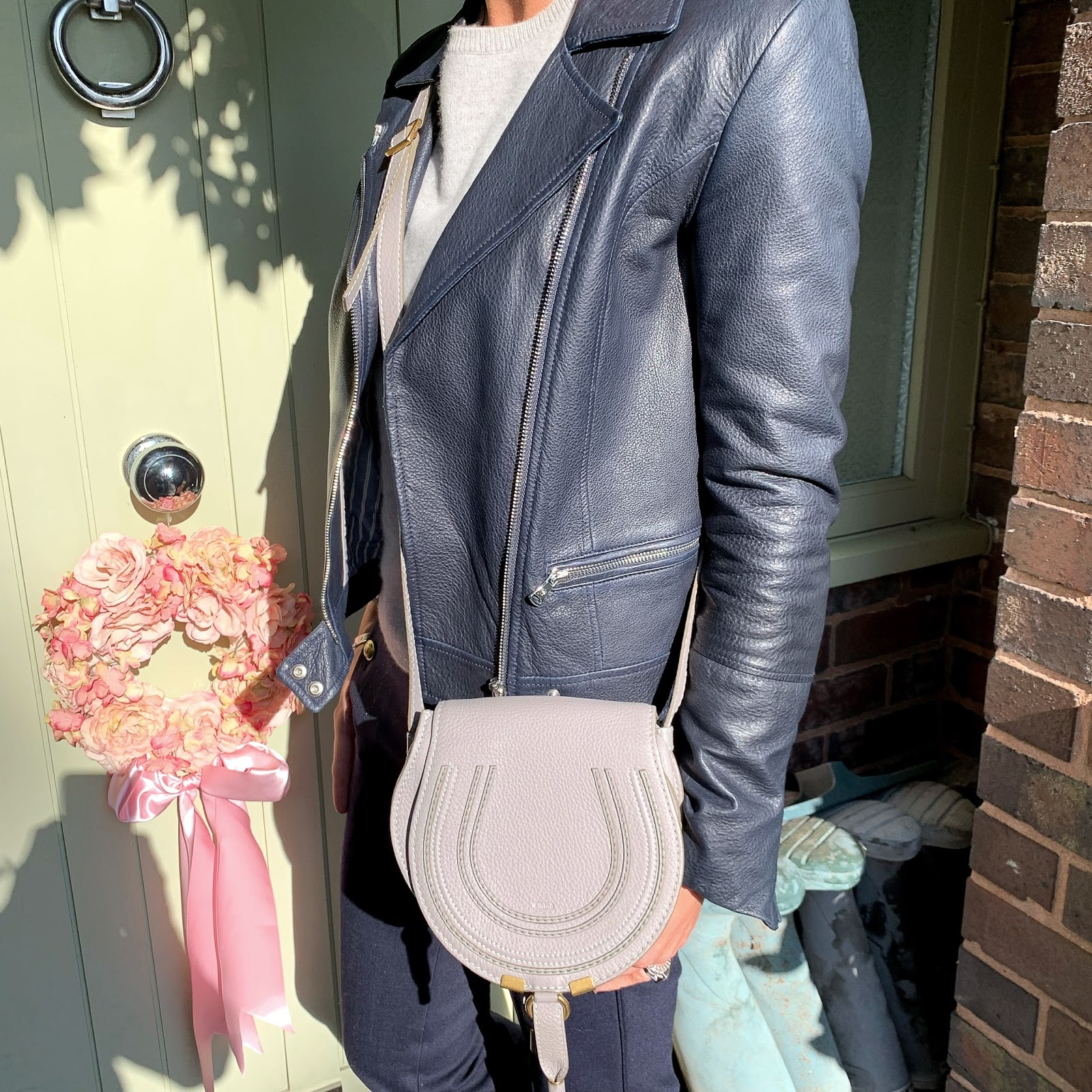 my midlife fashion, massimo dutti leather biker jacket, marks and spencer pure cashmere round neck jumper, chloe marcie small acrossbody bag, j crew cropped kick flare trousers, jones bootmake ella leather flat loafer