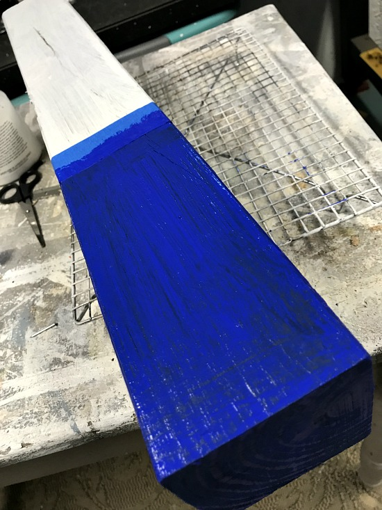 wooden firecracker for the fourth of July painted blue