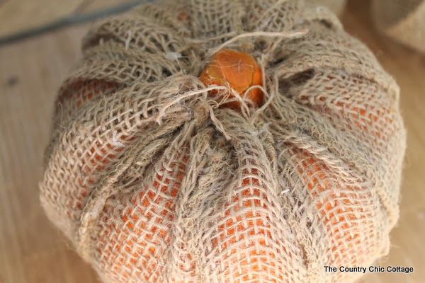 Make Your Own Burlap Pumpkin -- take a dollar store pumpkin and make it extra special with burlap!
