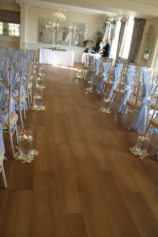 ... By Fresh Fragrant Rose Petals, The Team From Creative Cover Hire Had  Dressed The Chairs With Heavenly Blue Sateen And Lace Sashes Clasped With A  Brooch