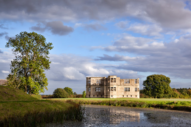 Northamptonshire Lyveden New Bield under fluffy clouds and a blue sky