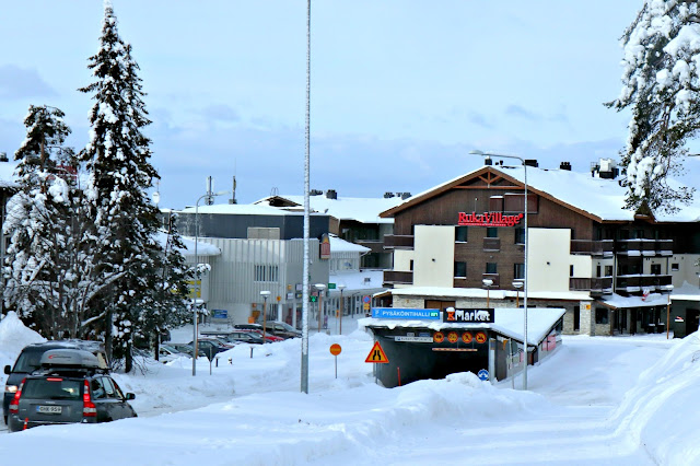 The entrance to Ruka village, with underground car park ramp.