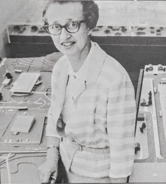 Herta Freyberg, TTC Architect in front of a model of Finch station.