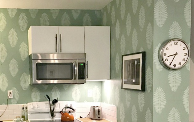 DIY leaf design using a rubber stamp on kitchen wall