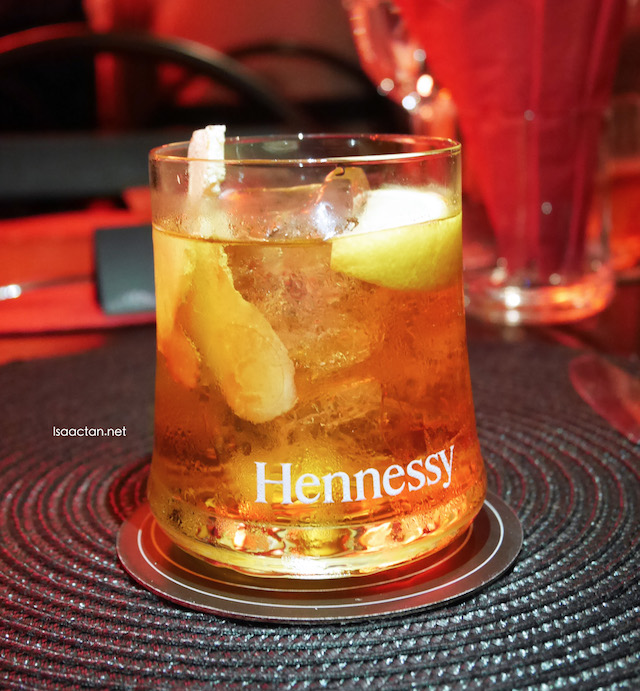 Horse's Neck (Hennessy V.S.O.P, Ginger Ale, Angostura Bitters and Lemon Wedges).
