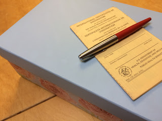 Photo includes cover of international vaccinations certificate from the 1970s.