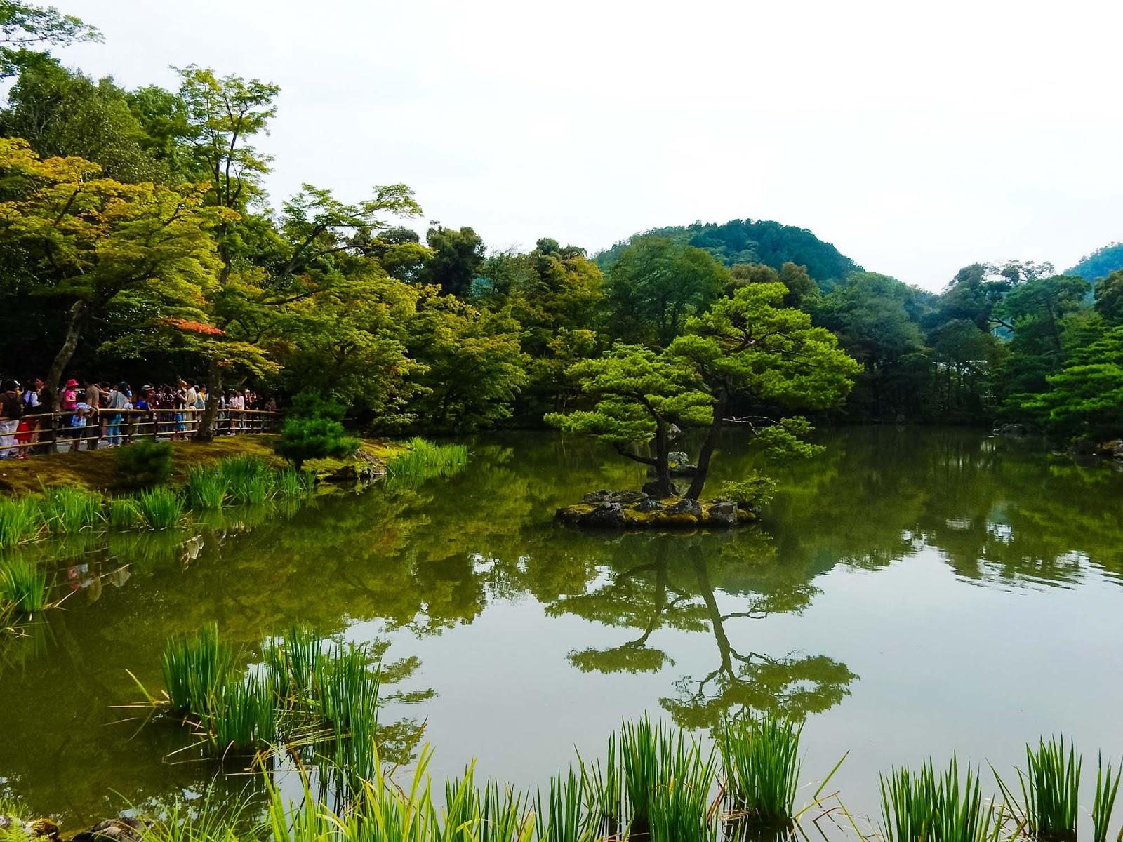 crowds at the grounds of kinkaku-ji temple