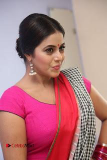 Actress Poorna Pictures in Red Salwar Kameez at Jayammu Nischayammu Raa Teaser Launch  0094.JPG